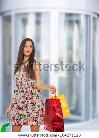 Shopping young woman with shopping bags in the mall.