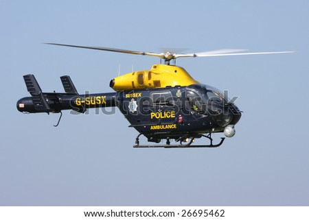 SHOREHAM AIRPORT,SUSSEX - SEPTEMBER 31 : The Sussex police helicopter arrives at the Battle of Britain Airshow on September 31, 2008 in Shoreham Airport, Sussex, United Kingdom.