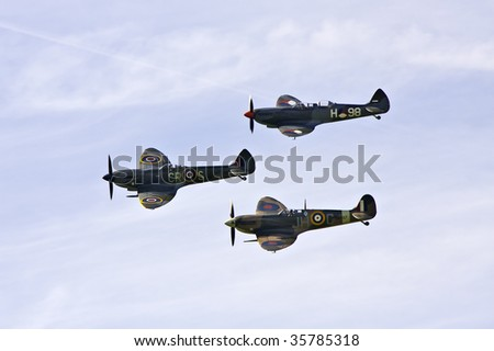 SHOREHAM, W SUSSEX - AUGUST 23: 3 restored English world war 2 aircraft perform a flypast at Shoreham airport airshow after a re-enactment of the Battle of Britain August 23, 2009 in Shoreham, UK