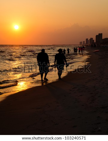 Shoreline of Panama City Beach at sunset - stock photo