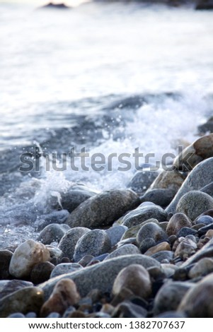 Shores of the Aegean sea. Stone beach. The wave rolls on the shore. Travel and tourism business. #1382707637