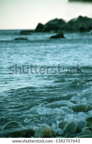 Shores of the Aegean sea. Stone beach. The wave rolls on the shore. Travel and tourism business. #1382707643