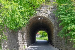 Short and Narrow Road Tunnel Passageway Stone Arch