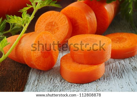 short carrot on wood background