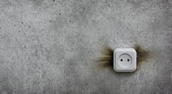 short circuit, smoking electrical outlet on the wall