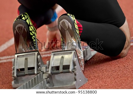 Short distance runner on gravity slope curve is in start position