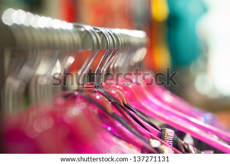 Short focus picture of hanger for clothes. Hanging in a row.