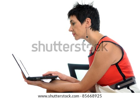 Short hair business woman on a laptop sitting in an office chair