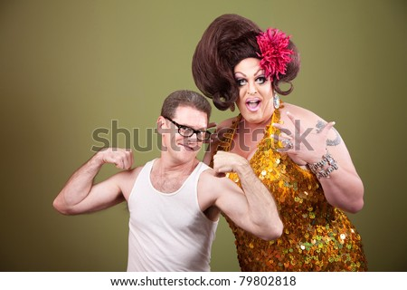 Short muscular man with impressed large drag queen