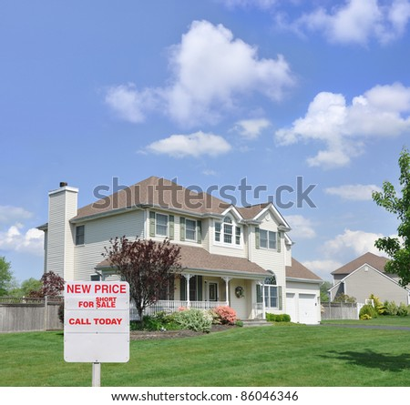 Short Sale For Sale Realtors Sign in Front of Beautiful Two Story Suburban Residential District Home Blue Cloud Sky Sunny Day