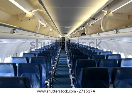 Shot down center aisle of an empty passenger jet - stock photo