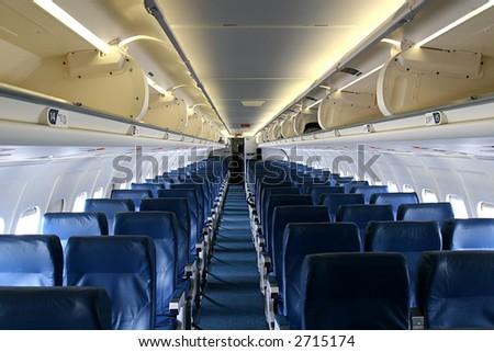 Shot down center aisle of an empty passenger jet