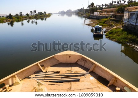 Shot from the front of a boat of the tranquil unspoiled beauty of the banks of the Nile