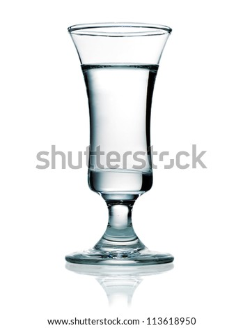 Shot glass filled with vodka which is a distilled beverage and one of the most popular alcoholic drinks