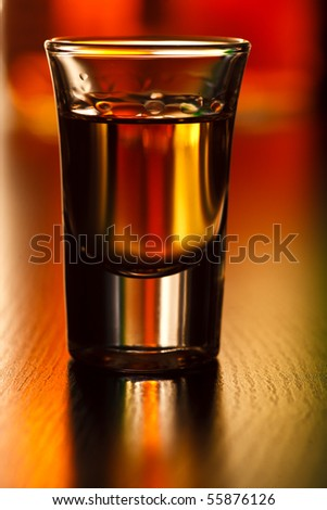Shot glass on a table, shallow focus