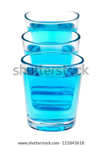 shot glasses with blue liquid