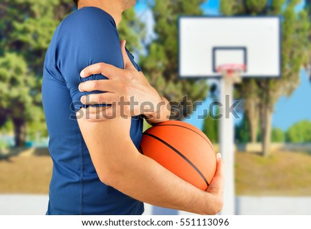 Shot of a basketball player with a shoulder injury at oudoors #551113096