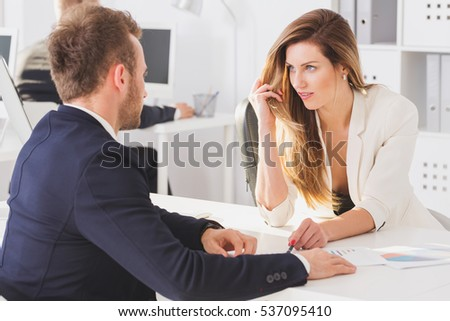 Shot of a beautiful businesswoman looking seductively at her colleague in the office