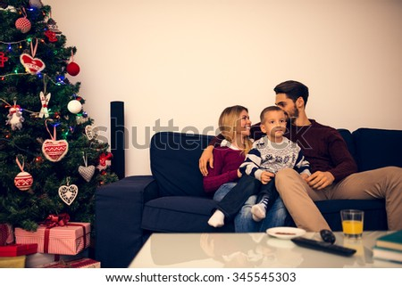 Shot of a beautiful happy family sitting on a sofa in living room.