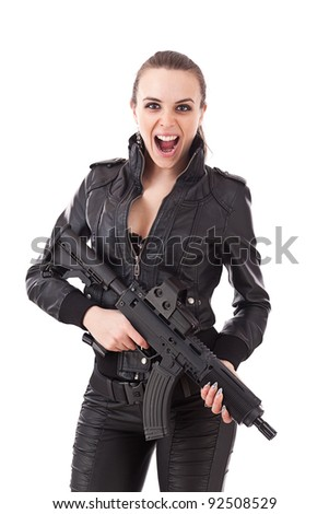 Shot of a beautiful woman posing with a guns