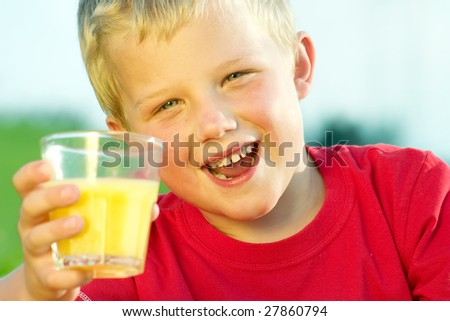 Shot of a boy drinking a glass of fresh orange juice