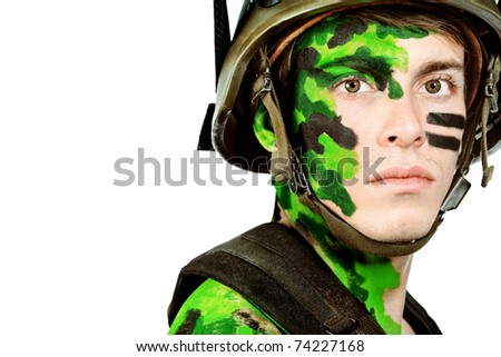 Shot of a conceptual soldier painted in khaki colors. Isolated over white background.