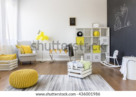 Shot of a creative baby room with a blackboard wall