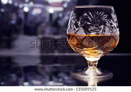 shot of a cut crystal glass containing brandy.