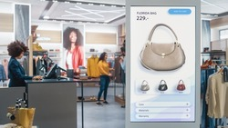 Shot of a Floor-Standing LCD Touch Screen Display with User Interface of Online Clothing Shop Standing in Clothing Store. Self service Checkout. Diverse People in Fashionable Shop Buying Clothes.