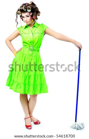 Shot of a funny  woman housewife dressed in retro style. - stock photo