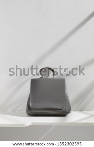 013357deffa098 Shot of a gray leather backpack with flap top and handle, isolated in the  middle