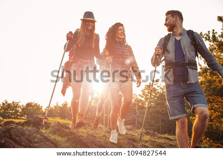 Shot of a group of friends trekking in the mountains