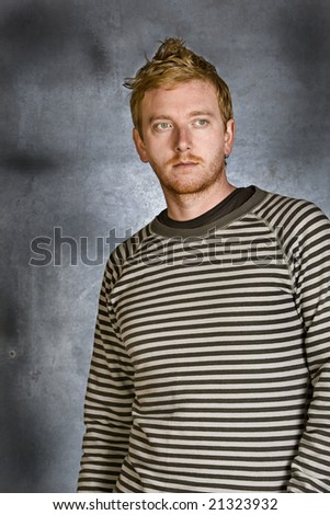 Shot of a Handsome Red Headed Male against Grunge Background