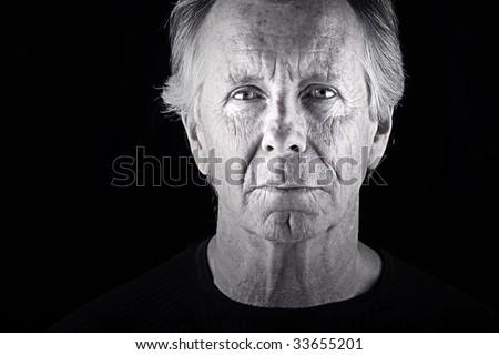 Shot of a Handsome Senior Man against a Dark Background