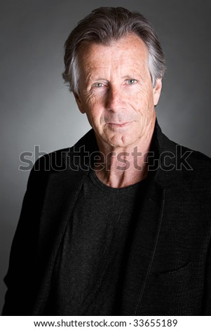 Shot of a Handsome Senior Man against a Grey Background