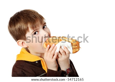 Shot of a hungry boy with a tasty hot dog.