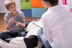 Shot of a little boy talking to a psychologist