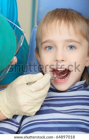 Shot of a little boy with a doctor in a dental surgery. Healthcare, medicine.