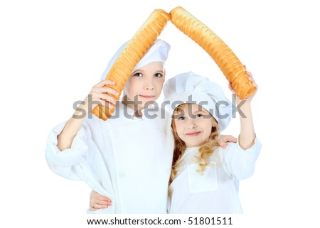 Shot of a little kitchen boy and girl in a white uniform. Isolated over white background. - stock photo