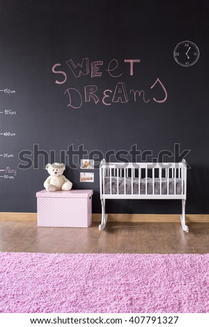 Shot of a modern baby room with a blackboard wall