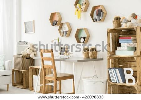 Shot of a modern children\'s room full of wooden furniture