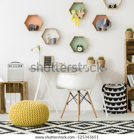 Shot of a modern comfortable room for kids with colorful shelves #525343651