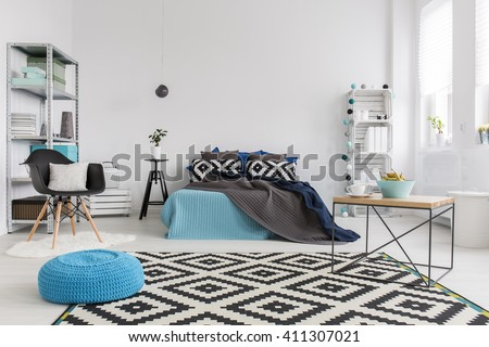 Shot of a modern cosy and spacious bedroom