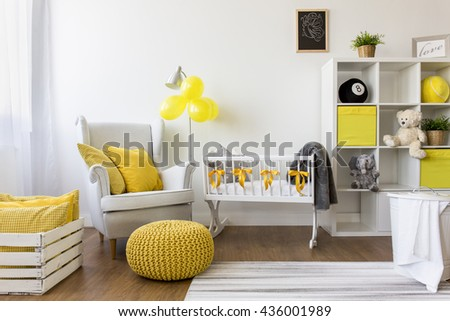 Shot of a modern cozy baby room with yellow accessories