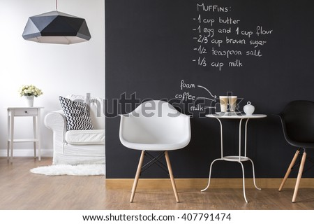 Shot of a modern room with a blackboard wall