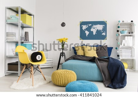 Shot of a modern yellow and blue bedroom