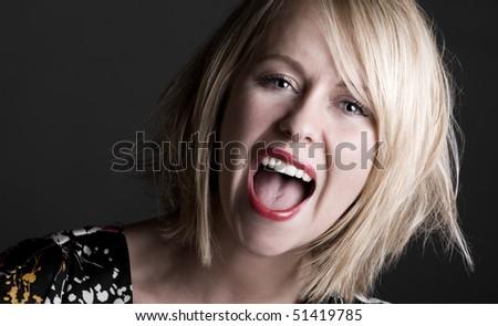 Shot of a Pretty Blonde Woman Shouting