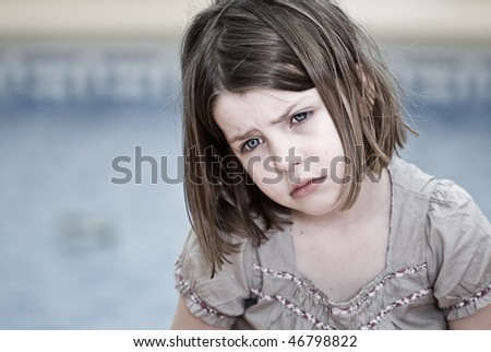 Shot of a Sad Looking Child on Holiday