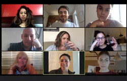 Shot of a screen of teammates doing a virtual happy hour from their home offices.  Team meeting from home during COVID-19 coronavirus pandemic.