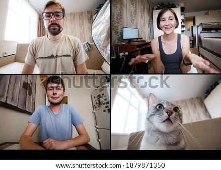 Shot of a screen of teammates doing a virtual happy hour from their home offices. Team meeting from home smiling multiethnic colleagues talk speak online brainstorm on video call and Funny Cat in chat